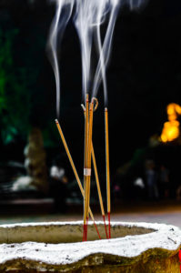 Incense or Joss Sticks with Rising Smoke.