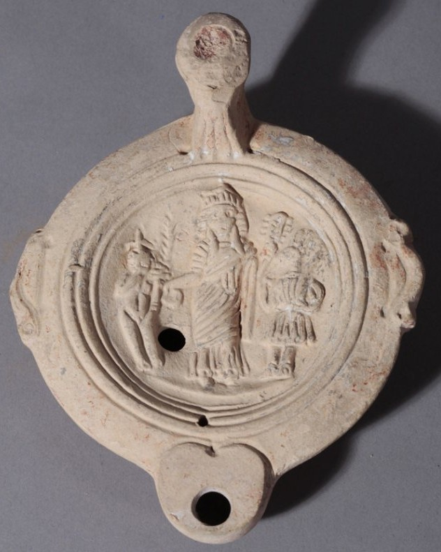 An oil lamp from Egypt, Roman period. It shows Isis and Harpocrates.