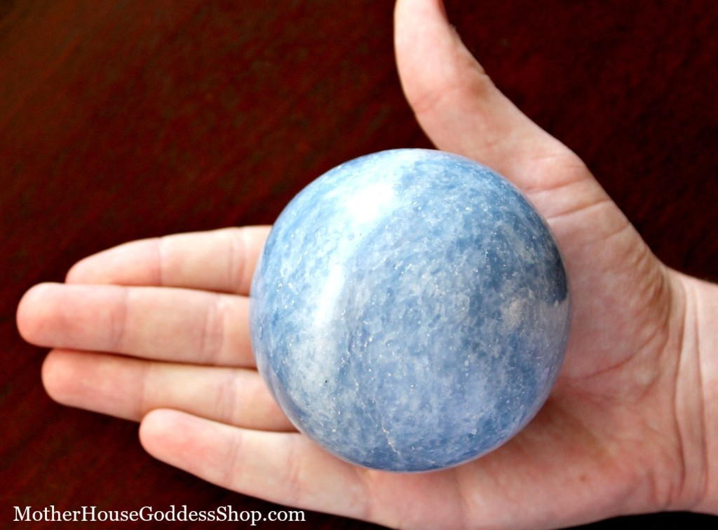 Blue Calcite Sphere in Hand from MotherHouse Goddess Shop