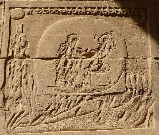 A rather destroyed image of Osiris on the back of a crocodile, Isis before them, from Philae