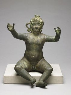 A Roman-era Harpokrates, reaching for His mother