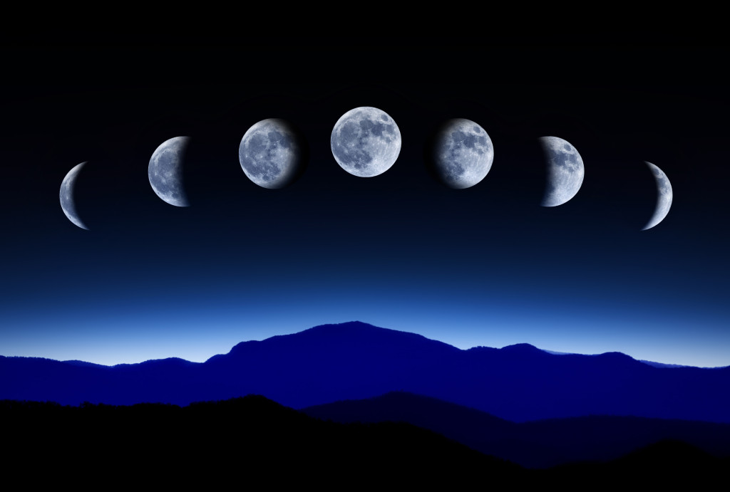 Moon lunar cycle in night sky, time-lapse concept
