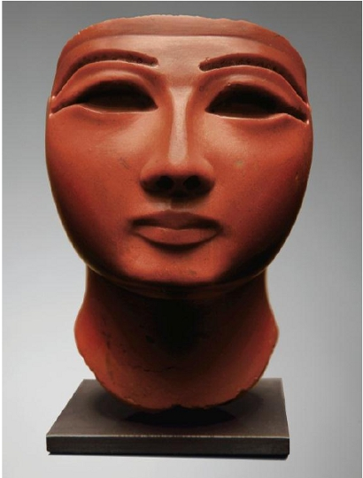 The head of a pharaoh carved of red jasper